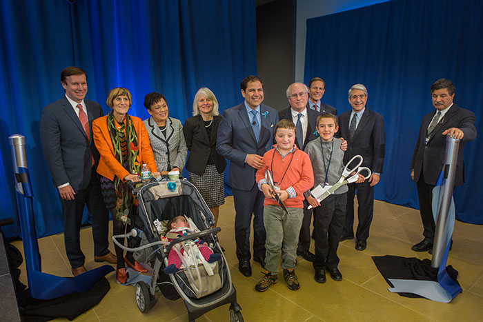 CEO David Hallal, Leonard Bell, Commissioner Catherine Smith, Mayor Toni Harp, Congresswoman Rosa Delauro, Senator Blumenthal, Senator Murphy, Yale University President Peter Salovey, and CFGNH Will Ginsberg at Alexion's Ribbon Cutting Ceremony on Rare Disease Day 2016